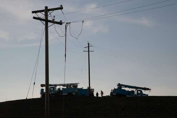 PG&E crews restoring electricity top of a blackened hill on Monday, Oct. 16, 2017 in Sonoma, CA.