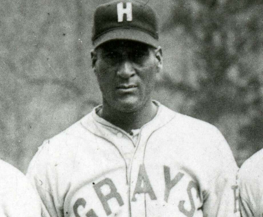 "Baseball Hall of Famer ""Smokey"" Joe Williams, a native of Seguin, poses with the Negro Leagues' Homestead Greys in 1931. Photo: National Baseball Hall Of Fame / Public domain."
