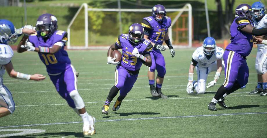 Westhill's Saquan Kelly carries the ball to a touchdown during Saturday's football game against Fairfield Ludlowe at Westhill High School in Stamford, Conn., on September 9, 2017. Photo: Lindsay Perry / For Hearst Connecticut Media / Stamford Advocate Freelance