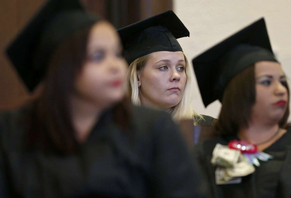 Bexar County Family Drug Court graduate Brianna Smith (center) and others listen to speakers during the 22nd biannual commencement ceremony held Friday Oct. 27, 2017 at the Bexar County Courthouse. The special Family Drug Court was formed in 2003, and brought a wealth of treatment to and intensive involvement with parents who have a CPS court case as well as a substance abuse problem.