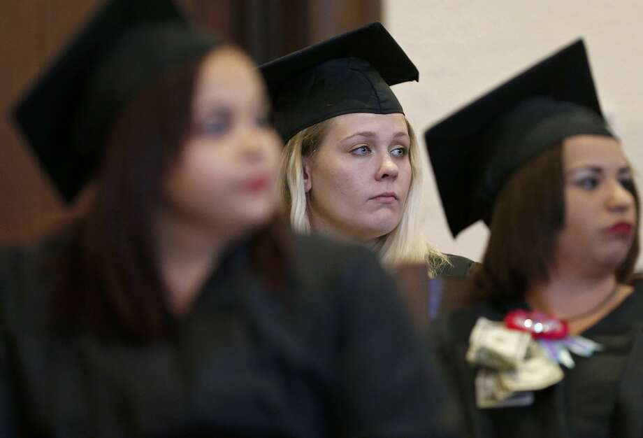 Bexar County Family Drug Court graduate Brianna Smith (center) and others listen to speakers during the 22nd biannual commencement ceremony held Friday Oct. 27, 2017 at the Bexar County Courthouse. The special Family Drug Court was formed in 2003, and brought a wealth of treatment to and intensive involvement with parents who have a CPS court case as well as a substance abuse problem. Photo: Edward A. Ornelas, Staff / San Antonio Express-News / © 2017 San Antonio Express-News