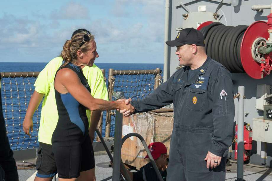 USS Ashland Command Master Chief Gary Wise welcomes aboard Jennifer Appel, an American mariner who had received assistance from Ashland crew members. The Ashland rescued two American mariners who had been in distress for several months after their sailboat had a motor failure and had strayed well off its original course. MUST CREDIT: U.S. Navy photo by Mass Communication Specialist 3rd Class Jonathan Clay / handout