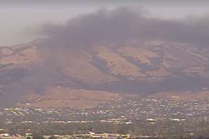 A trailer fire in the San Jose foothills Friday afternoon sent a plume of black smoke into the air, but firefighters stopped the blaze from spreading to a nearby house.