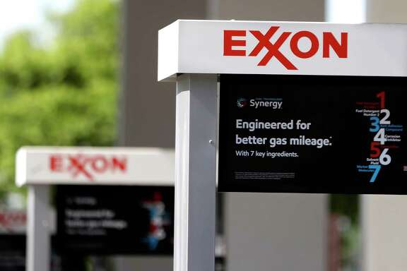 This April 25, 2017, photo, shows Exxon service station signs in Nashville, Tenn. Exxon Mobil Corp. reports earnings Friday, Oct. 27, 2017. (AP Photo/Mark Humphrey)