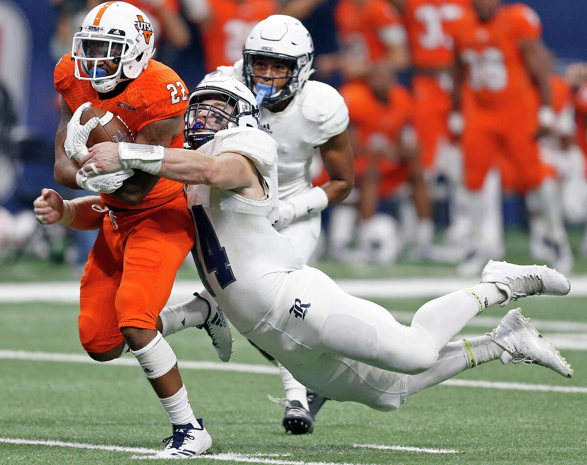 Rice's Brian Womac (44), tackling UTSA's Tyrell Clay last Saturday, is tied for fourth nationally with eight sacks, including three against the Roadrunners.