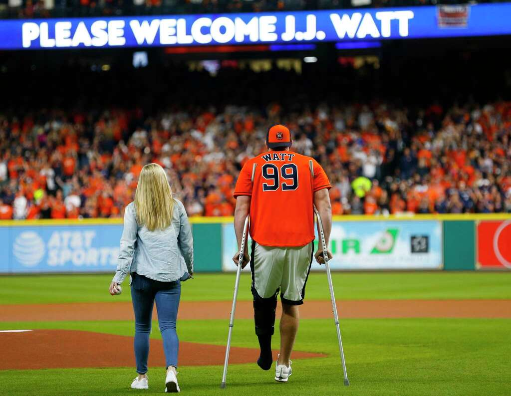 On crutches jj watt fires in first pitch before astros world jj watt walks onto the field with kealia ohai before throwing out the ceremonial first pitch kristyandbryce Image collections