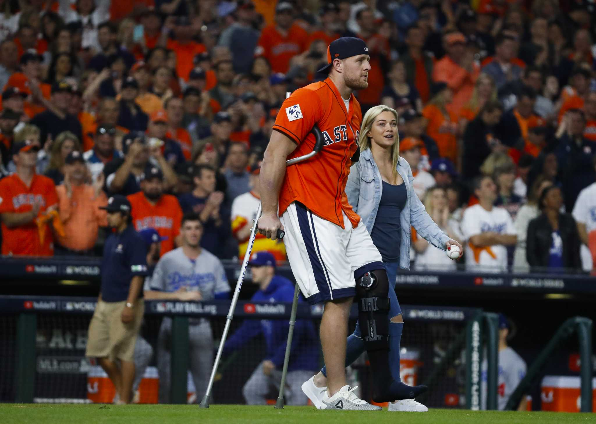 On crutches jj watt fires in first pitch before astros world on crutches jj watt fires in first pitch before astros world series game houston chronicle kristyandbryce Image collections