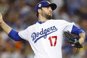 Los Angeles Dodgers relief pitcher Brandon Morrow (17) pitches in the eighth inning of Game 1 of the World Series at Dodger Stadium on Tuesday, Oct. 24, 2017, in Los Angeles. ( Brett Coomer / Houston Chronicle )