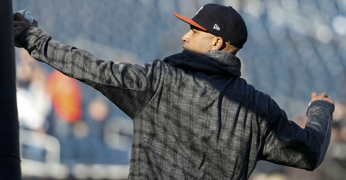 Houston Astros bullpen catcher Javier Bracamonte throws batting practice before Game 4 of the ALCS at Yankee Stadium on Tuesday, Oct. 17, 2017, in New York. ( Karen Warren / Houston Chronicle )