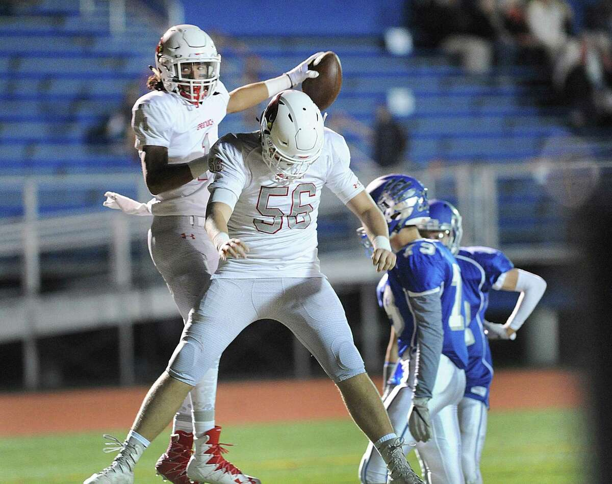 Greenwich receiver Jael Negron (#1), left, celebrates his first quarter touchdown catch on a pass from Gavin Muir with teammate Callum Abernethy (#56) during the high school football game between Fairfield Ludlowe High School and Greenwich High School at Fairfield Ludlowe High School, Conn., Friday night, Oct. 27, 2017.