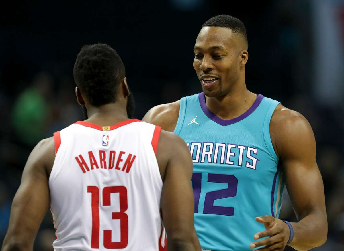 PHOTOS: James Harden and Dwight Howard together CHARLOTTE, NC - OCTOBER 27: Dwight Howard #12 of the Charlotte Hornets talks to James Harden #13 of the Houston Rockets before their game at Spectrum Center on October 27, 2017 in Charlotte, North Carolina. (Photo by Streeter Lecka/Getty Images)