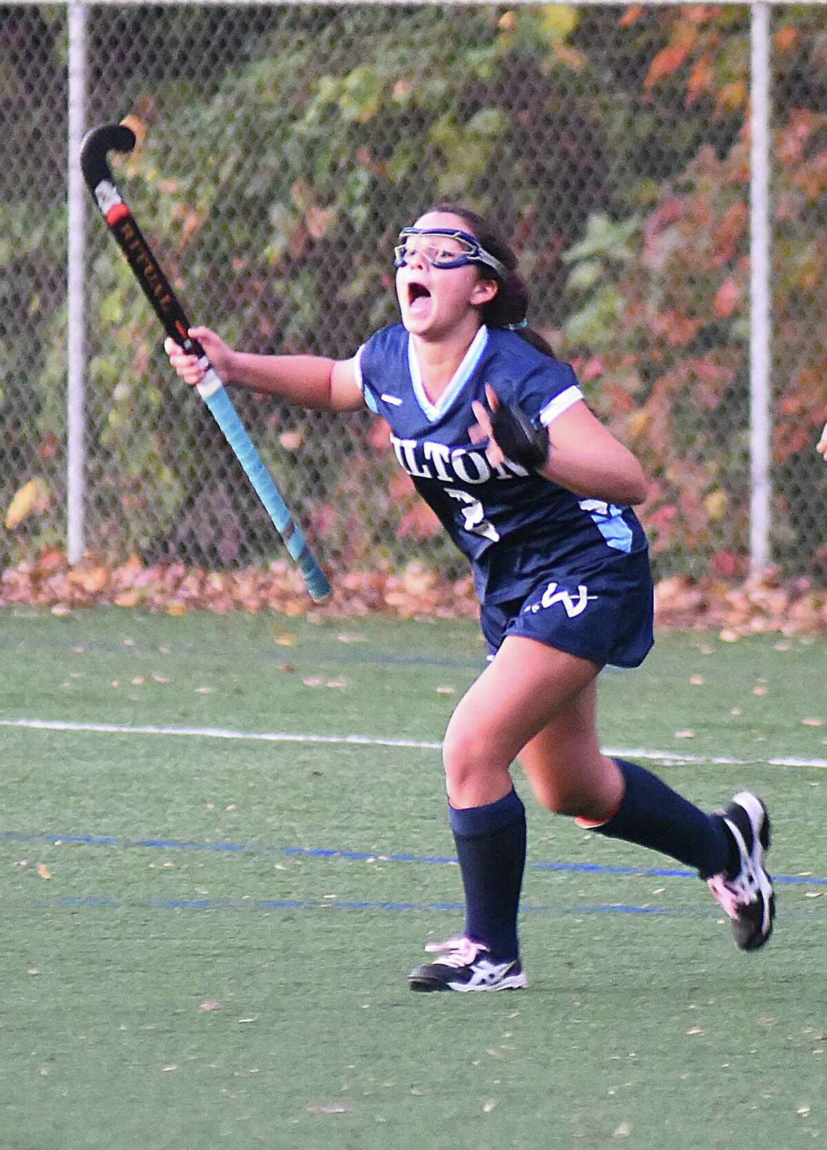 Wilton's Emma Rothkopf reacts after scoring the game-winning penalty stroke in double overtime to give the Warriors a 4-3 win over Staples in FCIAC quarterfinal field hockey action on Friday in Westport.