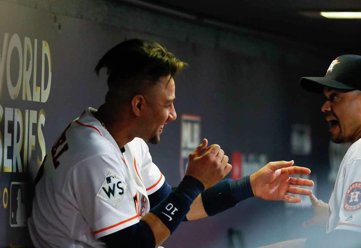 Houston Astros first baseman Yuli Gurriel (10) laughs in the dugout during the second inning of Game 3 of the World Series at Minute Maid Park on Friday, Oct. 27, 2017, in Houston.