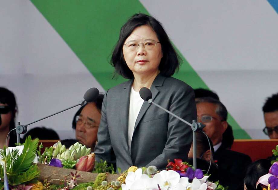 Taiwan's President Tsai Ing-wen delivers a speech during the National Day celebrations in front of the Presidential Building in Taipei on Oct. 10. Taiwan's President Tsai  is setting off for the United States and three South Pacific nations in an effort to crack the diplomatic isolation imposed by rival China.. (AP Photo/Chiang Ying-ying, File) Photo: Chiang Ying-ying, STR / Copyright 2017 The Associated Press. All rights reserved.
