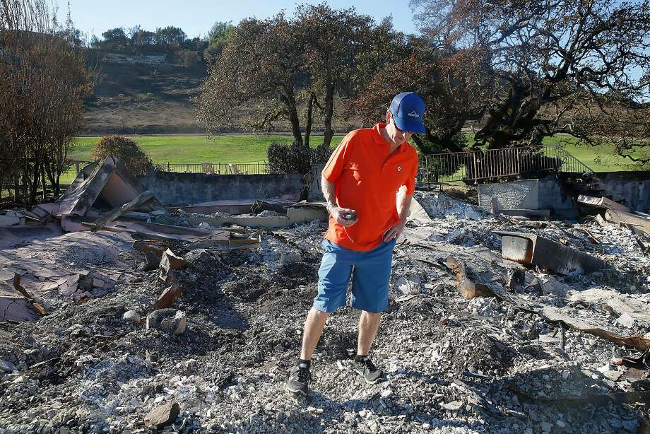 Ted Walsh, a longtime 49ers staffer, walks amid the ashes of his Santa Rosa home, where he found the face of his Super Bowl XXIII ring (below). Photo: Liz Hafalia, The Chronicle