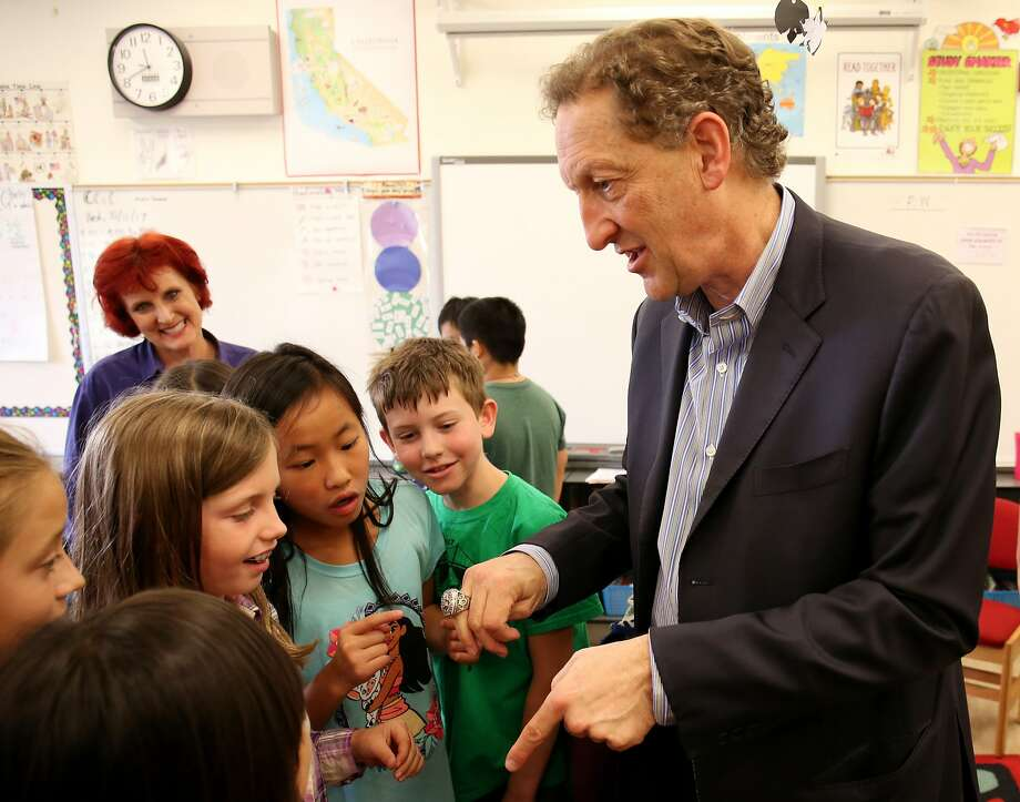 Larry Baer shows his ring from the 2014 World Series, one of three the Giants have won in San Francisco, to the Alamo fifth-graders. Photo: Beck Diefenbach, Special To The Chronicle