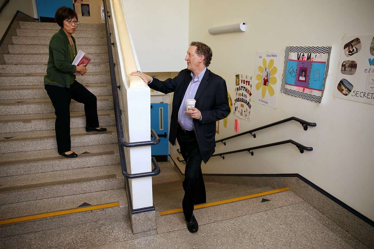 Baer talks with Alamo's Principal Rosa Fong during a visit to his old school.
