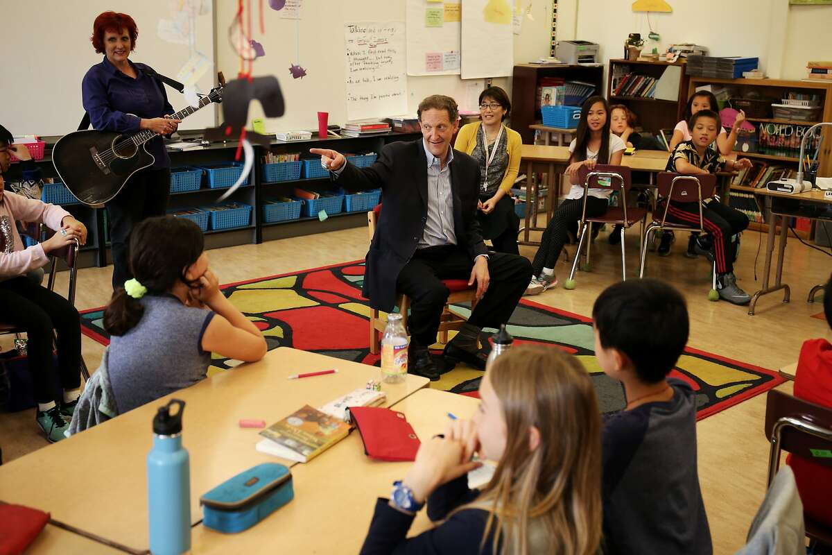 San Francisco Giants President and CEO Larry Baer talks and answers questions with the 5th grade class at Alamo School on October 11, 2017 in San Francisco, Calif.