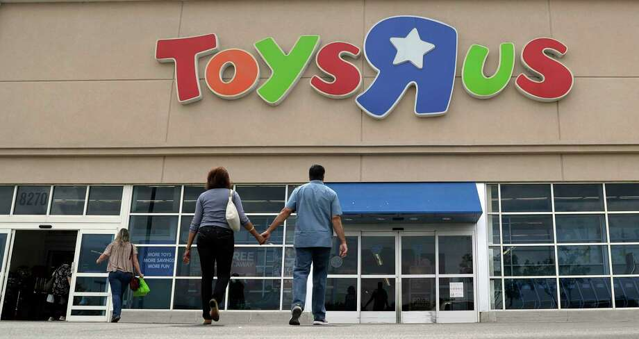 FLE - In this Sept. 19, 2017, photo, shoppers walk into a Toys R Us store, in San Antonio. There's trouble in toyland, and companies are blaming Toys R Us. Mattel, the maker of Barbie dolls and Hot Wheels cars, reported disappointing third-quarter results late Thursday, Oct. 26 and said it was hurt by Toys R Us' Chapter 11 bankruptcy filing last month. Hasbro, the maker of My Little Pony and Monopoly, had also blamed weak results on the Toys R Us situation.  (AP Photo/Eric Gay, File) Photo: Eric Gay, STF / Copyright 2017 The Associated Press. All rights reserved.