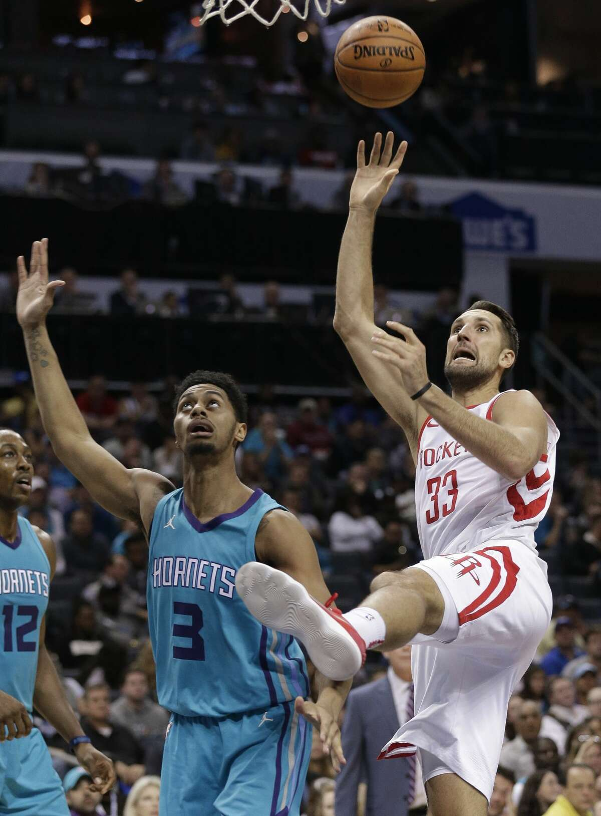 Houston Rockets' Ryan Anderson (33) shoots over Charlotte Hornets' Jeremy Lamb (3) during the second half of an NBA basketball game in Charlotte, N.C., Friday, Oct. 27, 2017. (AP Photo/Chuck Burton)