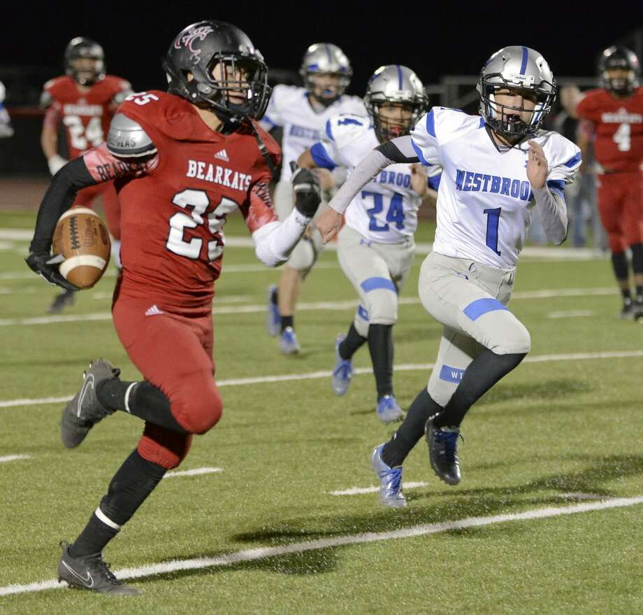 Garden City's Cesar Chavez looks to gain more yards as Westbrook's Noah King and others chase after him 10/27/17 at Bearcat Stadium. Tim Fischer/Reporter-Telegram Photo: Tim Fischer/Midland Reporter-Telegram
