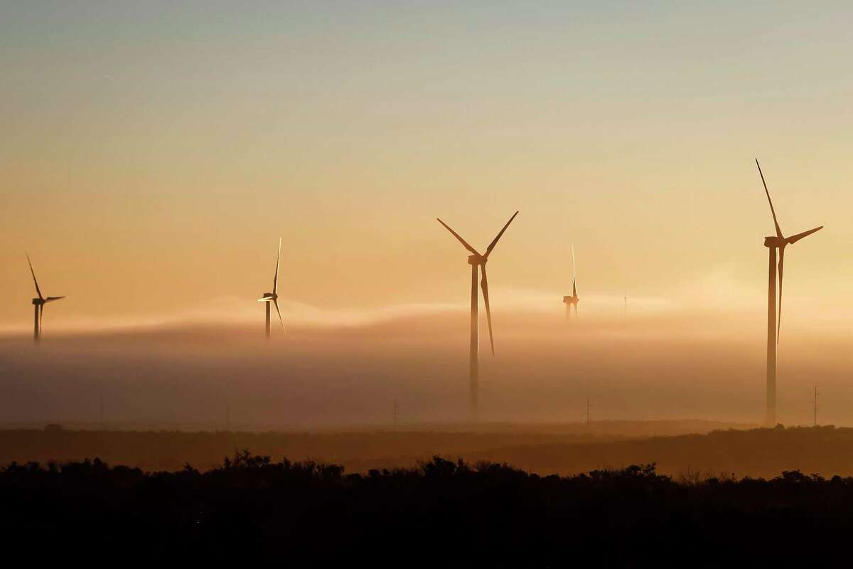 A thick cloud of fog and morning light engulfs several 285ft tall 2.5 MW Clipper wind turbines at the BP Sherbino Mesa II Wind Farm, Monday, Feb. 20, 2012, in Fort Stockton. After cutting its solar program last year, BP is beefing up its investments into wind energy and recently launched its fourth Texas wind farm, in Fort Stockton. On 20,000 acres in Pecos County, the Sherbino II farm has 60 wind turbines to generate enough electricity to power more than 175,000 homes. ( Michael Paulsen / Houston Chronicle )