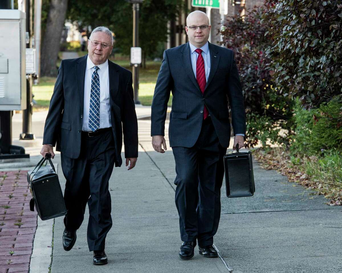 Rensselaer County District Attorney Joel Abelove, right, arrives with his attorney John Bailey at the Rensselaer City Hall to testify before a special Rensselaer County grand jury investigating a fatal Troy police shooting from April 2016 and his handling of the case Friday Oct. 27, 2017 in Rensselaer, N.Y. (Skip Dickstein/ Times Union)