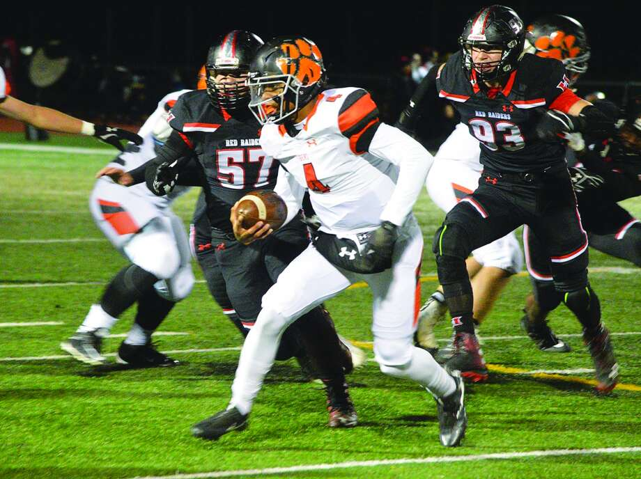 Edwardsville quarterback Kendall Abdur-Rahman looks for running room during first-half action against Huntley in the opening round of the IHSA Class 8A postseason on Friday. Photo: By SCOTT MARION