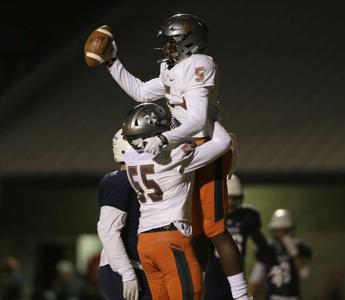 St. Pius X Panthers Jeremy Garcia (55) lifts St. Pius X Panthers Boobie Curry (5) in celebration after a touchdown in the first half during the high school football game between St. Pius X Panthers and the Concordia Lutheran Crusaders in Tomball, TX on Friday, October 27, 2017.