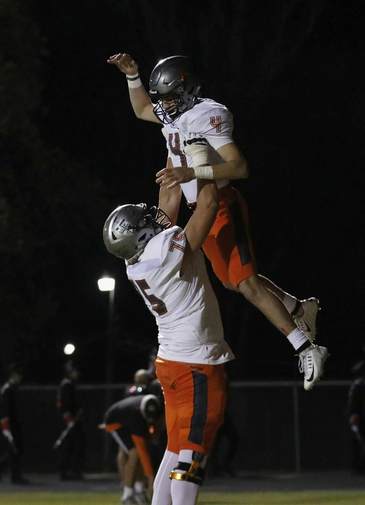 St. Pius X Panthers Tyler Vrabel (75) celebrates with St. Pius X Panthers wide receiver Ramon Vitulli (4) after a touchdown in the first half during the high school football game between St. Pius X Panthers and the Concordia Lutheran Crusaders in Tomball, TX on Friday, October 27, 2017.