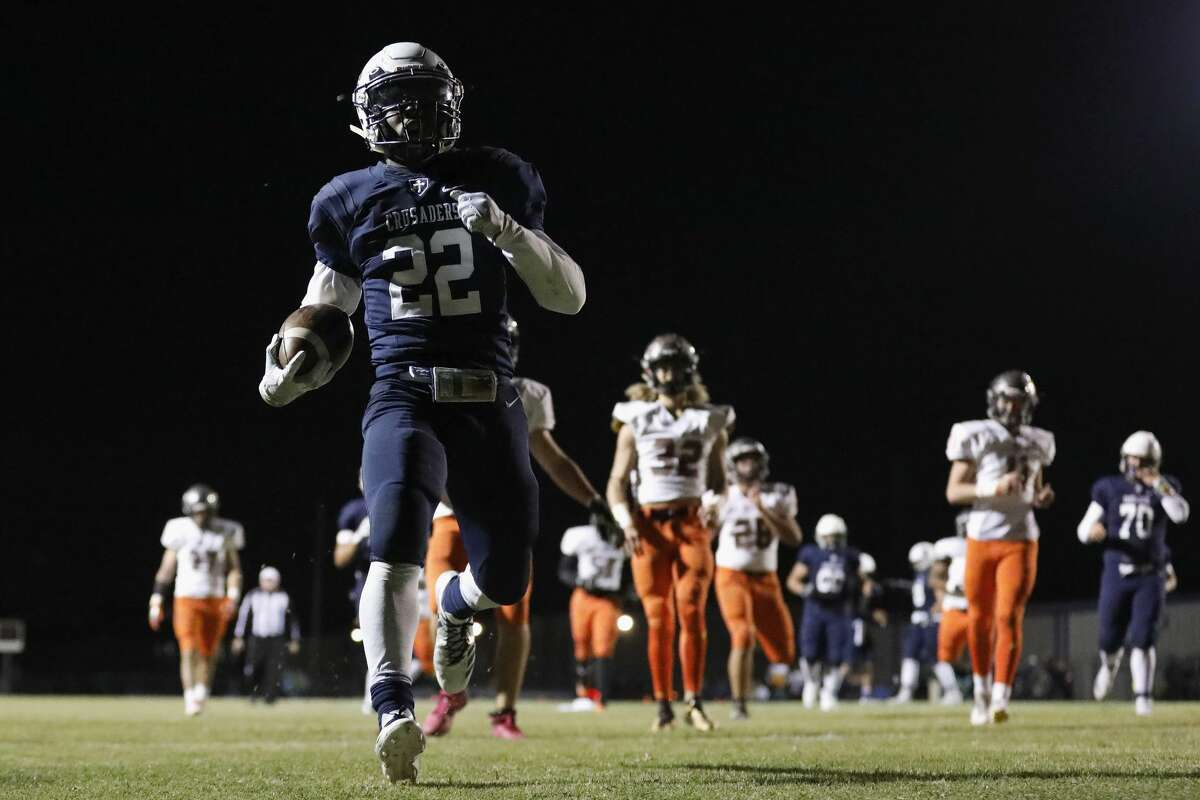 Concordia Lutheran Crusaders Kendahl Ross (22) rushes for a touchdown in the first half during the high school football game between St. Pius X Panthers and the Concordia Lutheran Crusaders in Tomball, TX on Friday, October 27, 2017.