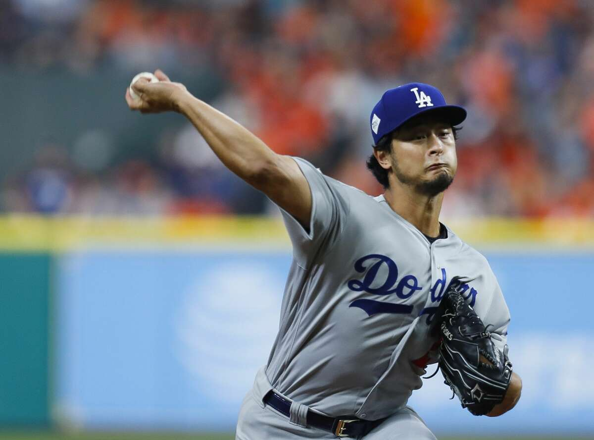 Los Angeles Dodgers starting pitcher Yu Darvish (21) pitches during the first inning of Game 3 of the World Series at Minute Maid Park on Friday, Oct. 27, 2017, in Houston.