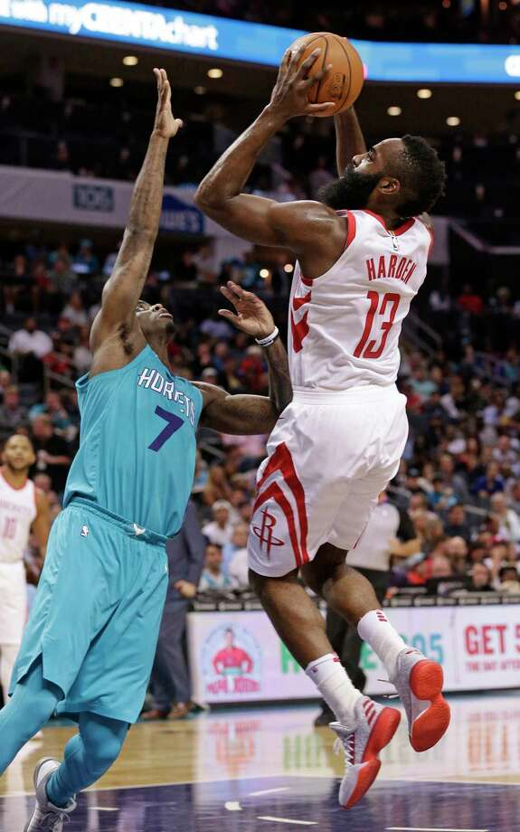 Rockets guard James Harden shoots over the Hornets' Dwayne Bacon on his way to a triple-double - 27 points, 10 rebounds and 11 assists. Photo: Chuck Burton, STF / Copyright 2017 The Associated Press. All rights reserved.
