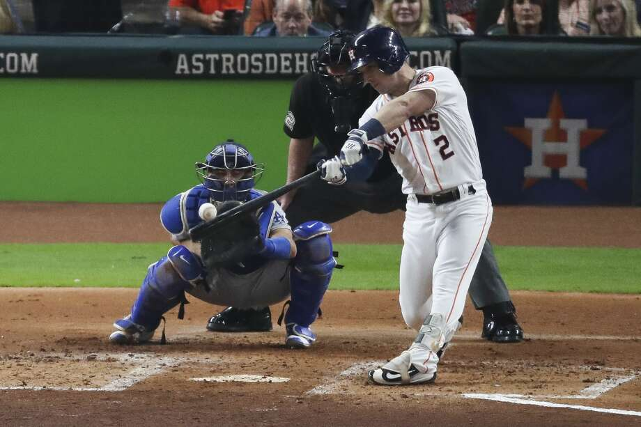 Houston Astros third baseman Alex Bregman (2) hits a sacrifice fly to center field to bring in a run during the second inning as the Houston Astros take on the Los Angeles Dodgers in Game 3 of the World Series at Minute Maid Park Friday, Oct. 27, 2017 in Houston. Photo: Michael Ciaglo/Houston Chronicle