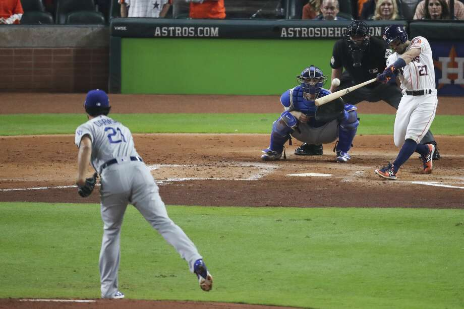 Houston Astros second baseman Jose Altuve hits a double off Dodgers starter Yu Darvish during the second inning Friday night at Minute Maid Park. The Astros went on to win 5-3 and took a 2-1 series lead. Photo: Michael Ciaglo/Houston Chronicle