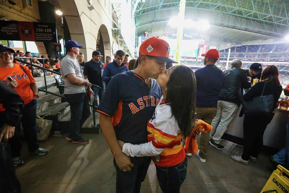 Carlos Perez and his wife, Alice, share a kiss before Game 3 of the World Series at Minute Maid Park. Photo: Steve Gonzales, Houston Chronicle / © 2017 Houston Chronicle