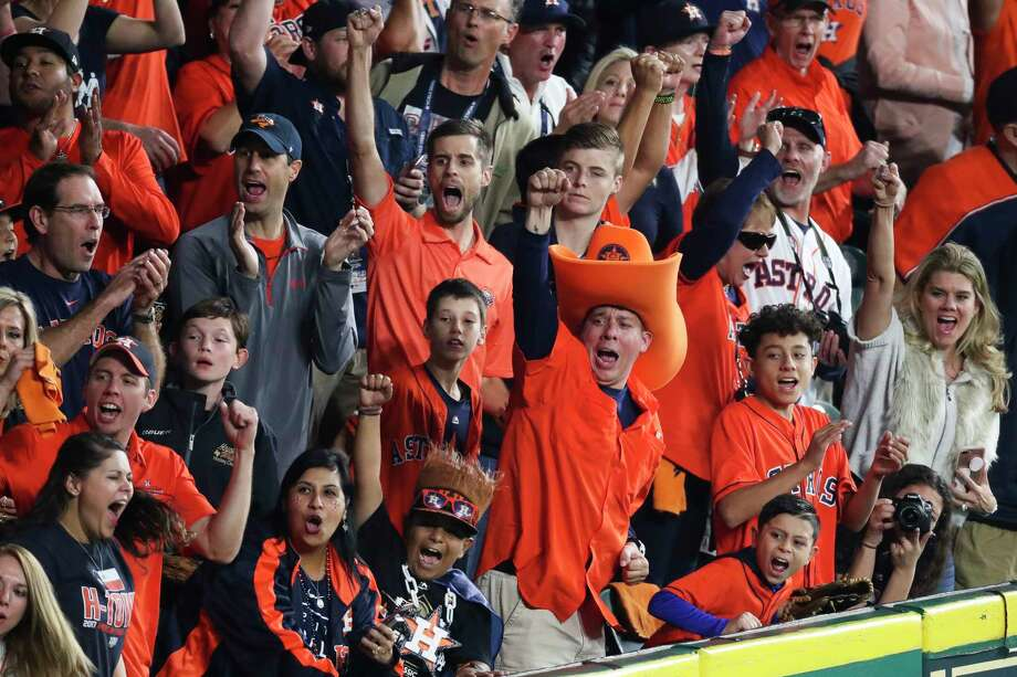 Fans whoop it up as Astros center fielder George Springer tracks down a long fly ball to end the top of the first inning of Game 3 on Friday night at Minute Maid Park. For complete coverage of Game 3, go to houstonchronicle.com/astros. Photo: Michael Ciaglo, Houston Chronicle / Michael Ciaglo
