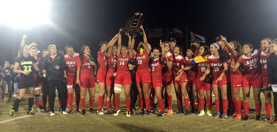 The Lamar soccer team raises the Southland Conference trophy after defeating McNeese, 4-1, to win the outright regular-season title Friday at the Lamar Soccer Complex in Beaumont. (Matt Faye/The Enterprise)