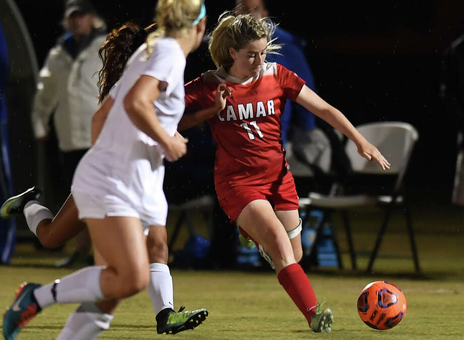 Lamar's Lucy Ashworth drives the ball against McNeese during the Cardinal's matchup at Lamar on Friday. Photo taken Guiseppe Barranco/The Enterprise Photo: Guiseppe Barranco, Photo Editor / Guiseppe Barranco ©