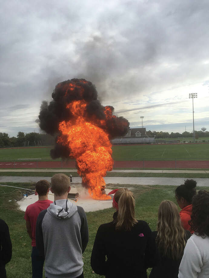 About 150 students in the foods classes at Edwardsville High School received a demonstration from Edwardsville Fire Department Captain James Whiteford and firefighter Brett Milton on what can happen when flour is used to put out a kitchen fire and moisture is introduced into a turkey fryer. The students also practiced putting out a small grease fires using approved fire extinguishers. Photo: Bill Craft • For The Intelligencer