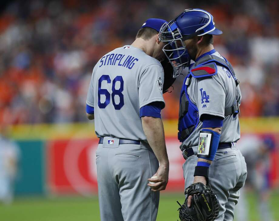 Los Angeles Dodgers relief pitcher Ross Stripling (68) and catcher Austin Barnes (15) talk on the mound during the seventh inning of Game 3 of the World Series at Minute Maid Park on Friday, Oct. 27, 2017, in Houston. Photo: Brett Coomer/Houston Chronicle