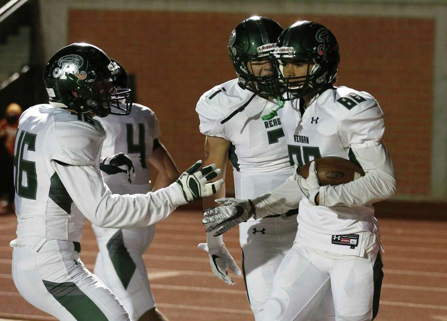Reagan players congratulate teammate Drew Ureste, right, after his touchdown catch against Johnson during a game at Heroes Stadium on Oct. 27. Photo: Kin Man Hui /San Antonio Express-News / ©2017 San Antonio Express-News