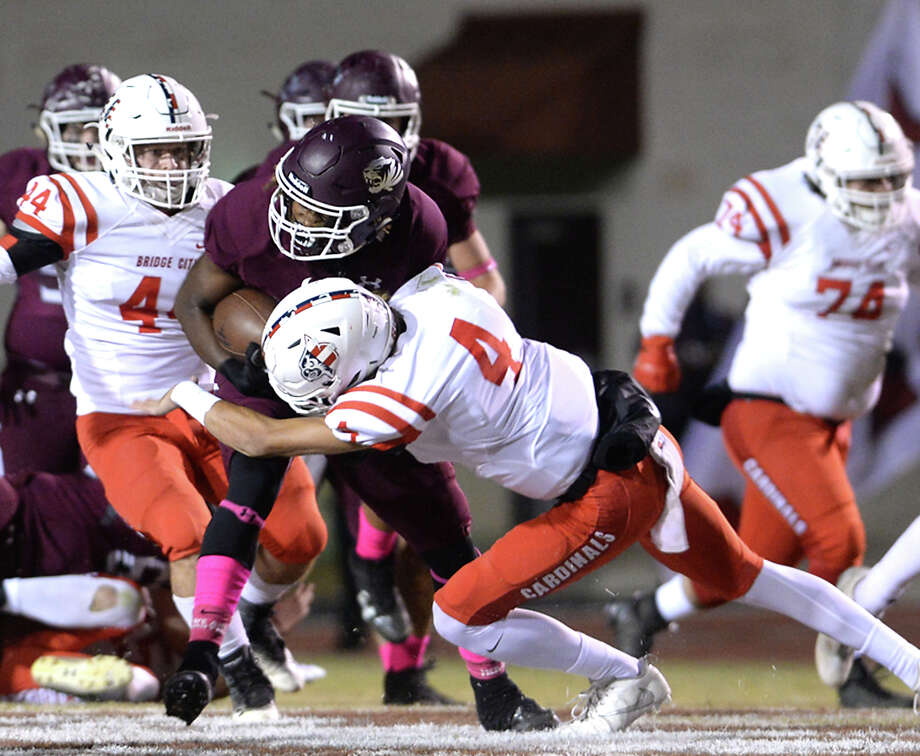 Silsbee's Christopher Martin is tackled by Bridge City's Justin Romero during their district game Friday night in Silsbee. Photo taken Friday, October 27, 2017 Kim Brent/The Enterprise Photo: Kim Brent / BEN