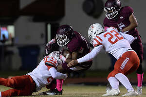Silsbee's Dralyn Taylor is brought down by Bridge City's Brennon Tregre (left) and Logan Hamm during their district game Friday night in Silsbee. Photo taken Friday, October 27, 2017 Kim Brent/The Enterprise