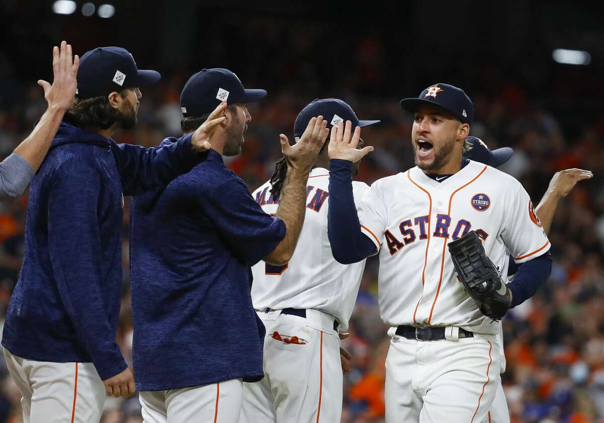 Houston Astros center fielder George Springer (4) celebrates the Astros 5-3 win in Game 3 of the World Series at Minute Maid Park on Friday, Oct. 27, 2017, in Houston.