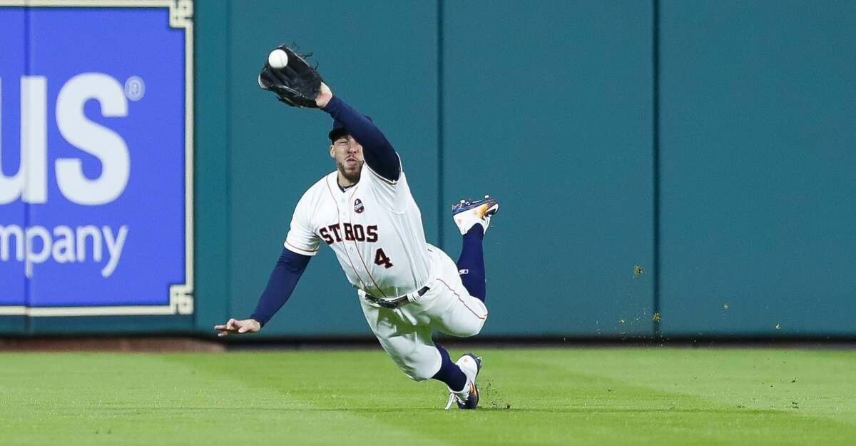 Houston Astros center fielder George Springer (4) catches a Los Angeles Dodgers third baseman Chris Taylor line drive to end the top of the fifth inning of Game 3 of the World Series at Minute Maid Park on Friday, Oct. 27, 2017, in Houston. ( Brett Coomer / Houston Chronicle )