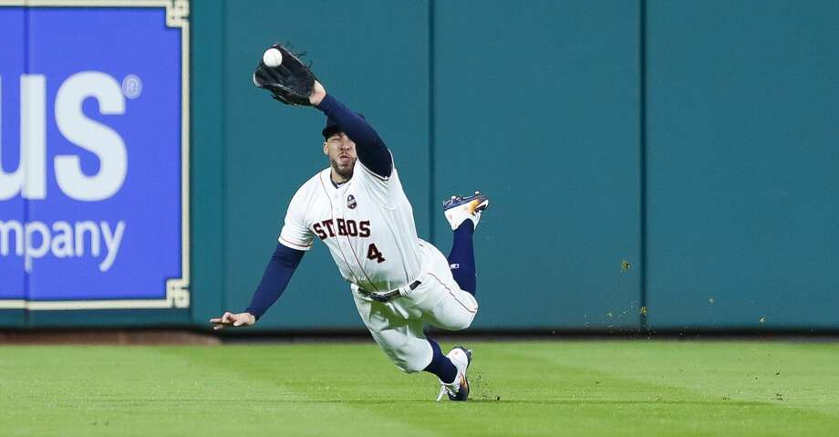Houston Astros center fielder George Springer (4) catches a Los Angeles Dodgers third baseman Chris Taylor line drive to end the top of the fifth inning of Game 3 of the World Series at Minute Maid Park on Friday, Oct. 27, 2017, in Houston. ( Brett Coomer / Houston Chronicle ) Photo: Brett Coomer/Houston Chronicle