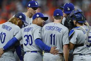 Los Angeles Dodgers manager Dave Roberts (30) meets his players on the mound during the second inning of Game 3 of the World Series at Minute Maid Park on Friday, Oct. 27, 2017, in Houston. ( Brett Coomer / Houston Chronicle )