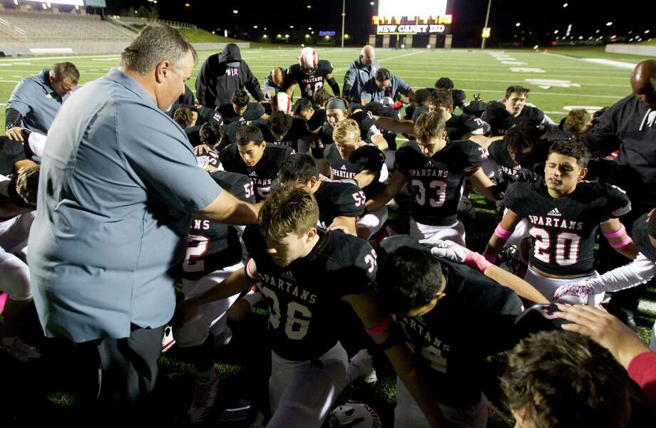 Porter players and coaches pray following the team's 28-13 District 21-5A win over Humble at Texan Drive Stadium, Friday, Oct. 27, 2017, in New Caney. Photo: Jason Fochtman, Staff Photographer / © 2017 Houston Chronicle