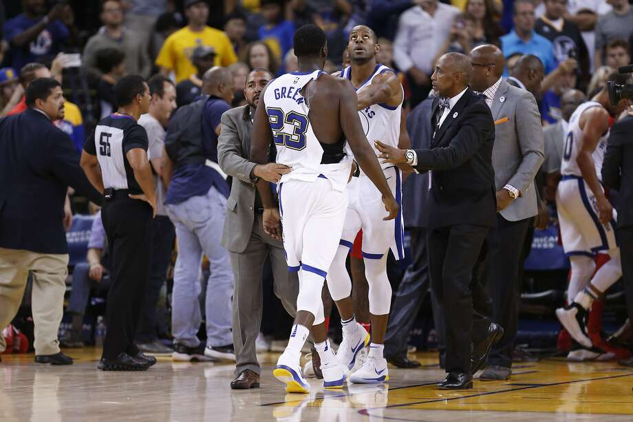 Warriors Draymond Green is led away after a brawl on the floor Wizards Bradley Beal as the Golden State Warriors take on the Washington Wizards during the first half in NBA action at Oracle Arena in Oakland, Ca. on Friday October 27, 2017. Photo: Michael Macor, The Chronicle